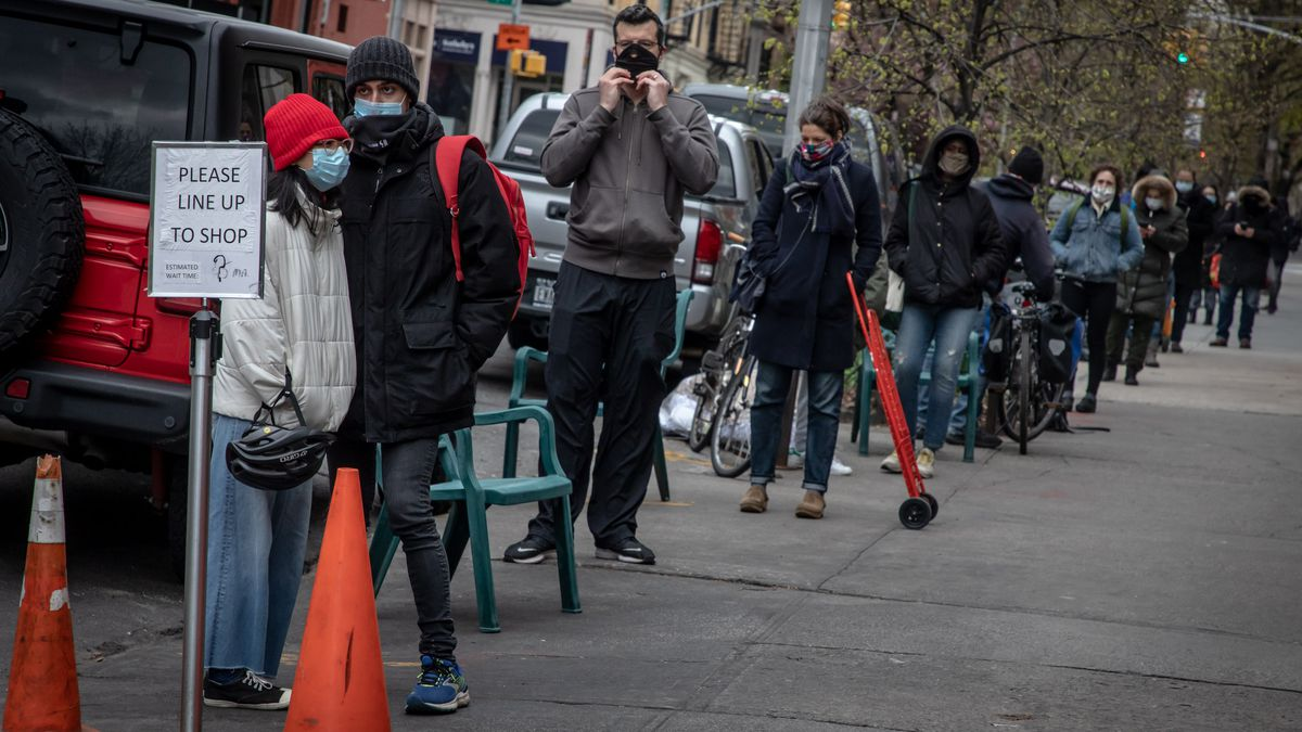 Park Slope Food Coop members waiting in a line that stretches down the block to enter the store.
