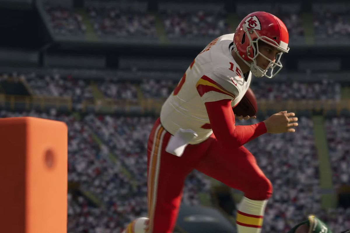 Patrick Mahomes of the Kansas City Chiefs running toward the end zone pylon against the Green Bay Packers in Madden NFL 21