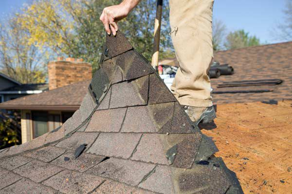 Re-Roofing With Underneath Layers Of Roof Shingles
