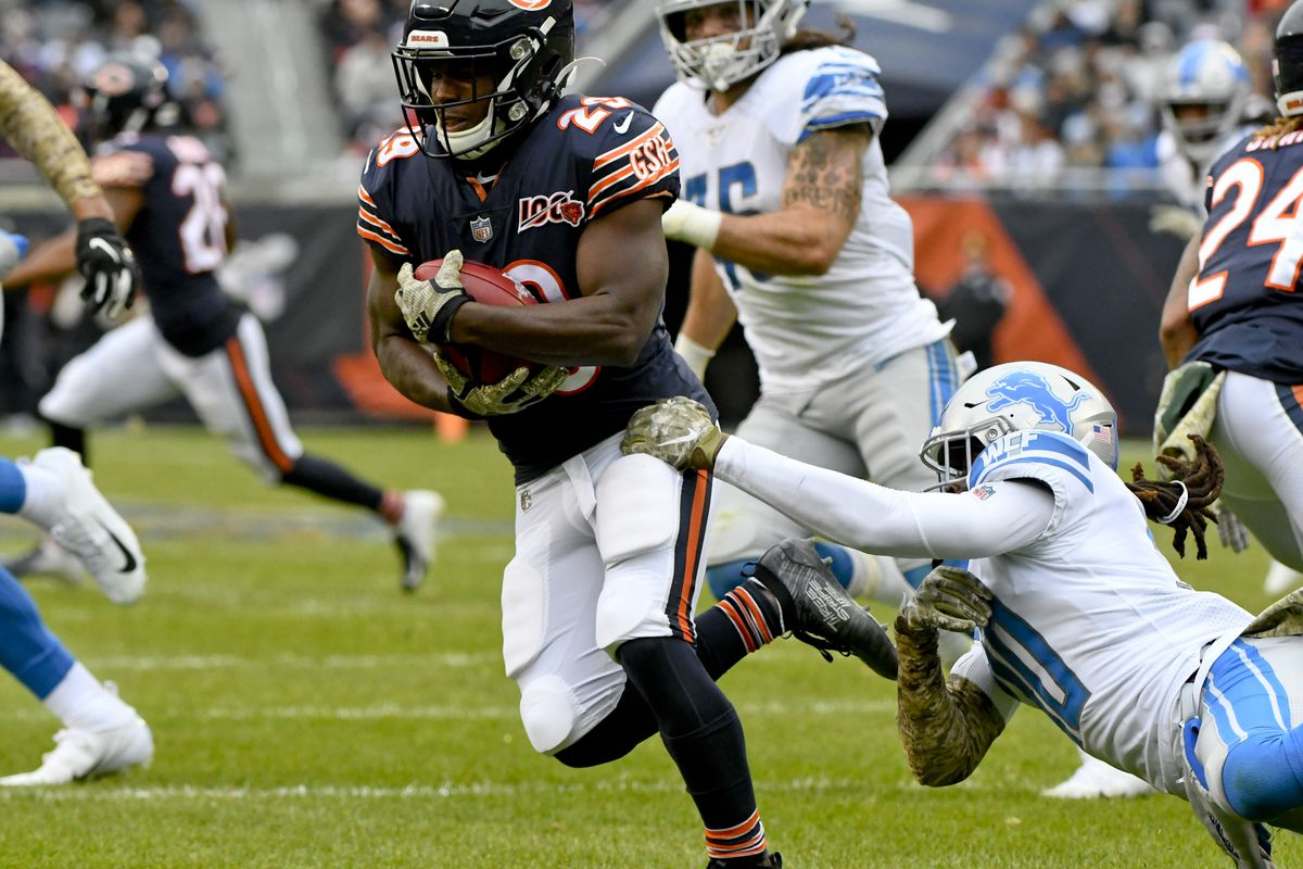 Detroit Lions defensive back Dee Virgin tackles Chicago Bears running back Tarik Cohen (29) in the first half at Soldier Field.