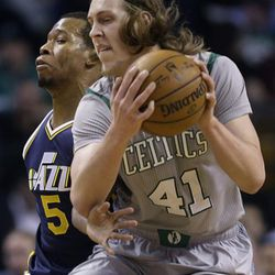 Boston Celtics center Kelly Olynyk (41) makes a move with the ball against Utah Jazz guard Rodney Hood (5) during the first half of an NBA basketball game in Boston, Wednesday, March 4, 2015. (AP Photo/Elise Amendola)
