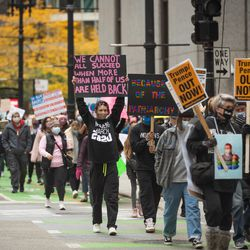 Protesters march from Federal Plaza to Daley Plaza in the Loop during the Women's March.