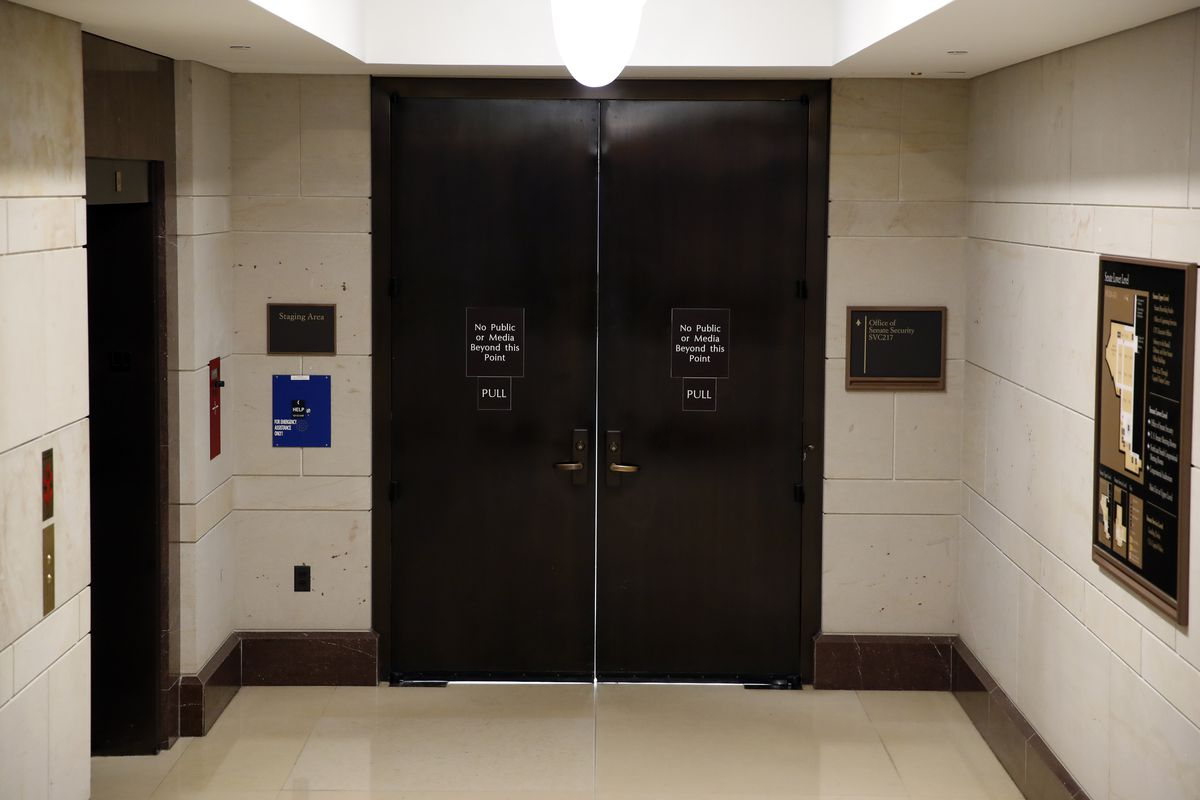 The entrance to the Office of Senate Security is seen on Capitol Hill, Wednesday night, Oct. 3, 2018 in Washington. (AP Photo/Alex Brandon)