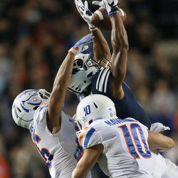 Brigham Young Cougars wide receiver Jonah Trinnaman (3) can't come up with the catch against the defense of Boise State Broncos cornerback Avery Williams (26) in Provo on Friday, Oct. 6, 2017.