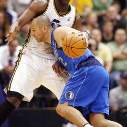 Utah Jazz center Al Jefferson (25) stops Dallas Mavericks guard Jason Kidd (2) from getting into the paint as the Utah Jazz and the Dallas Mavericks play Monday, April 16, 2012 in Salt Lake City.