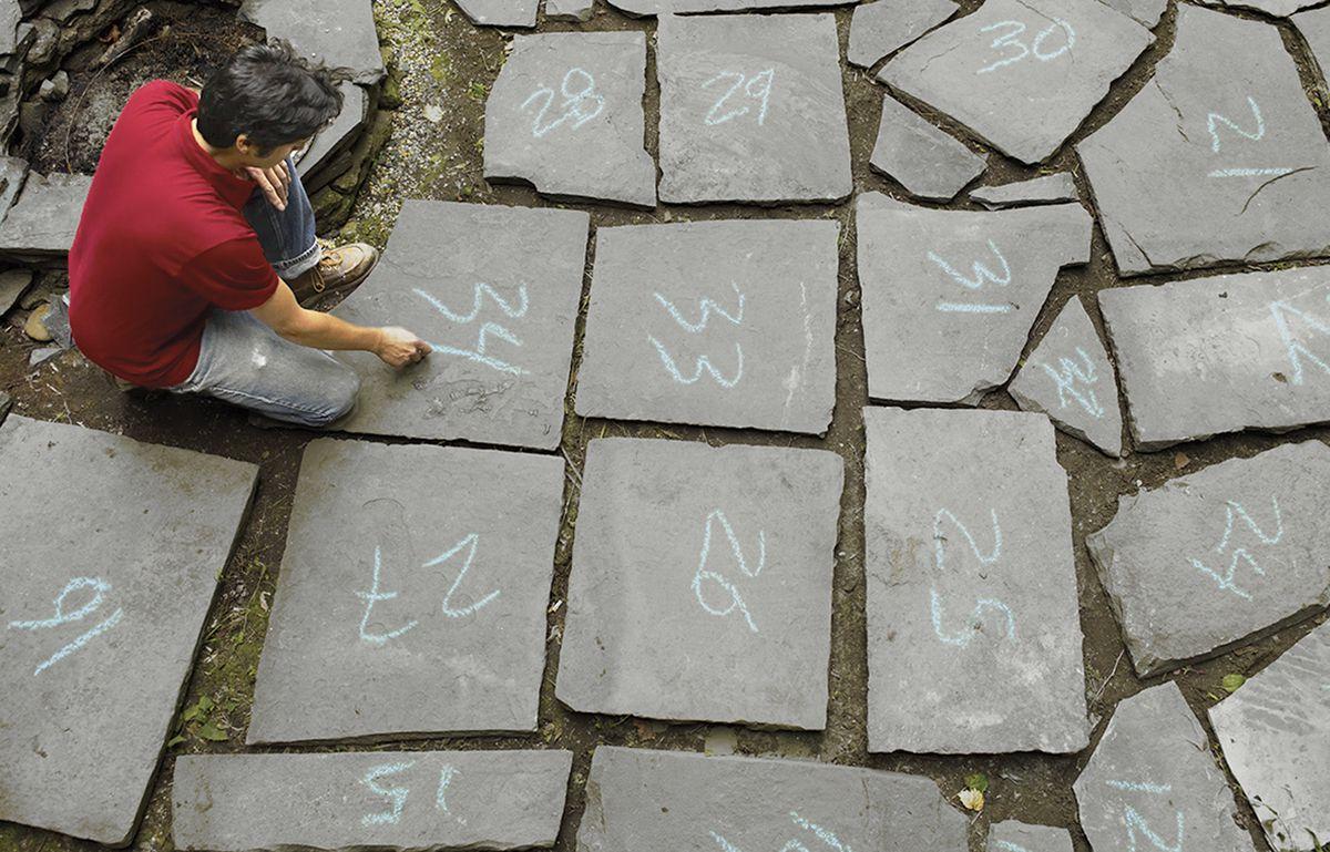 Man Numbering Stones For Bluestone Patio