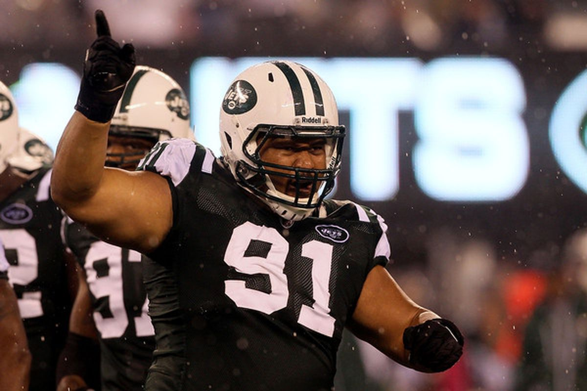 EAST RUTHERFORD, NJ - OCTOBER 11:  Sione Pouha #91 of the New York Jets reacts against the Minnesota Vikings at New Meadowlands Stadium on October 11, 2010 in East Rutherford, New Jersey.  (Photo by Jim McIsaac/Getty Images)