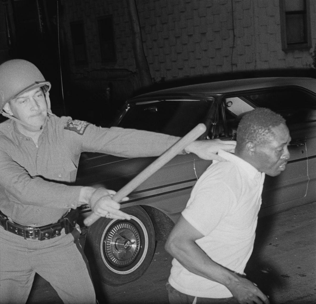 cop bobby stick watts riots
