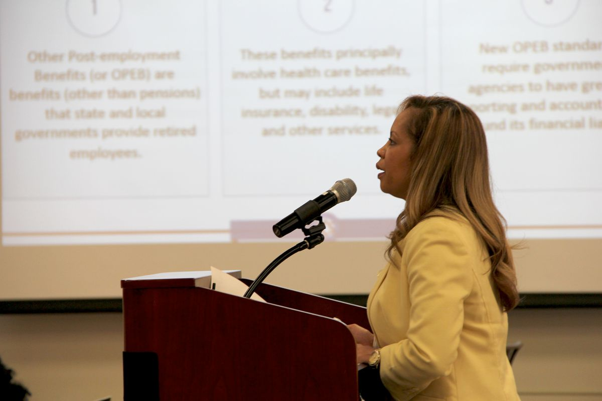 Shelby County Schools Human Resources Director Trinette C. Small presents options Monday evening to the district's Board of Education in Memphis.