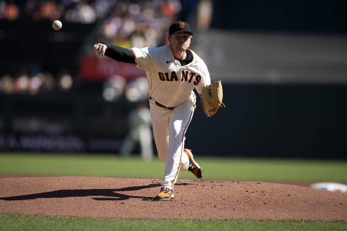 San Francisco Giants starting pitcher Logan Webb (62) delivers a pitch against the San Diego Padres during the first inning at Oracle Park.