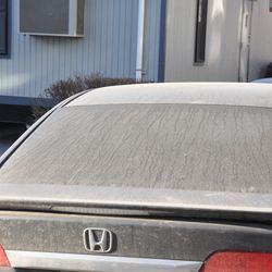 Very dusty car parked on Seminary -