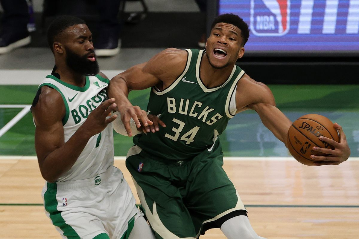 Giannis Antetokounmpo of the Milwaukee Bucks is defended by Jaylen Brown of the Boston Celtics during the second half of a game at Fiserv Forum on March 24, 2021 in Milwaukee, Wisconsin.