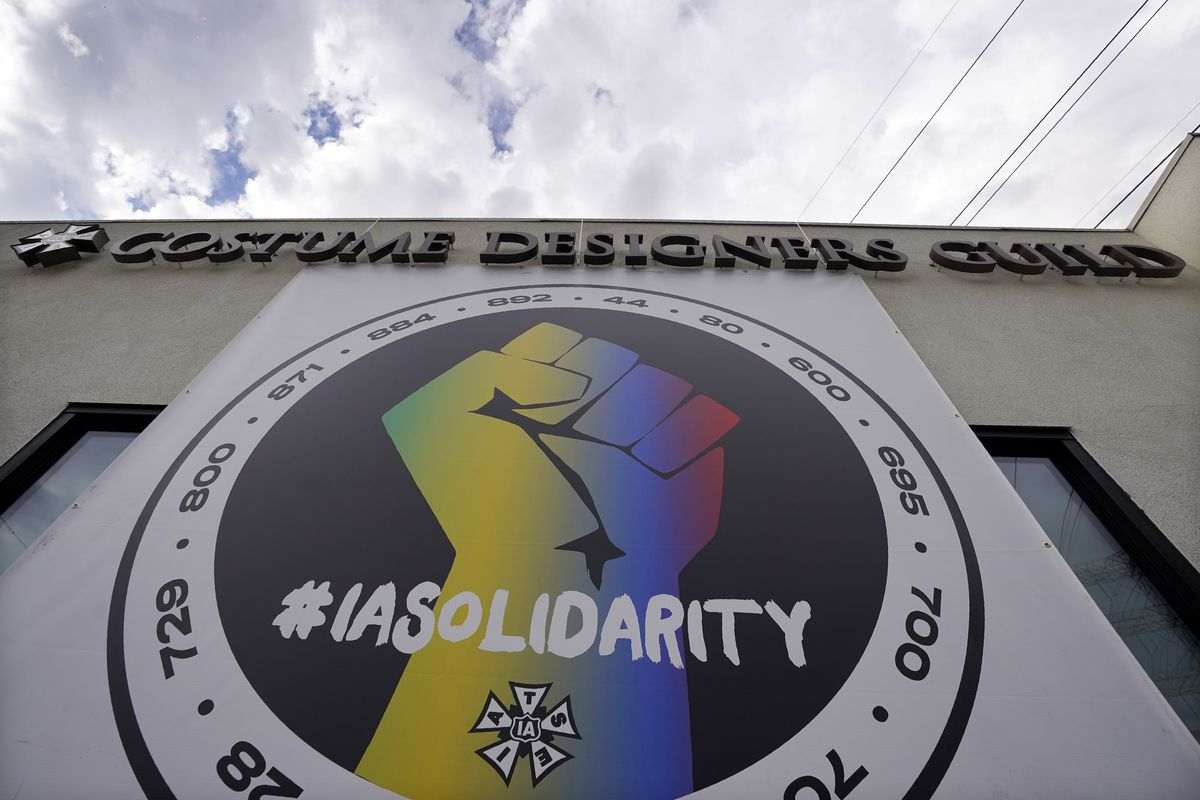 A poster advocating union solidarity hangs from a Costume Designers Guild office building, Monday, Oct. 4, 2021, in Burbank, Calif. The International Alliance of Theatrical Stage Employees (IATSE) overwhelmingly voted to authorize a strike for the first time in its 128-year history.