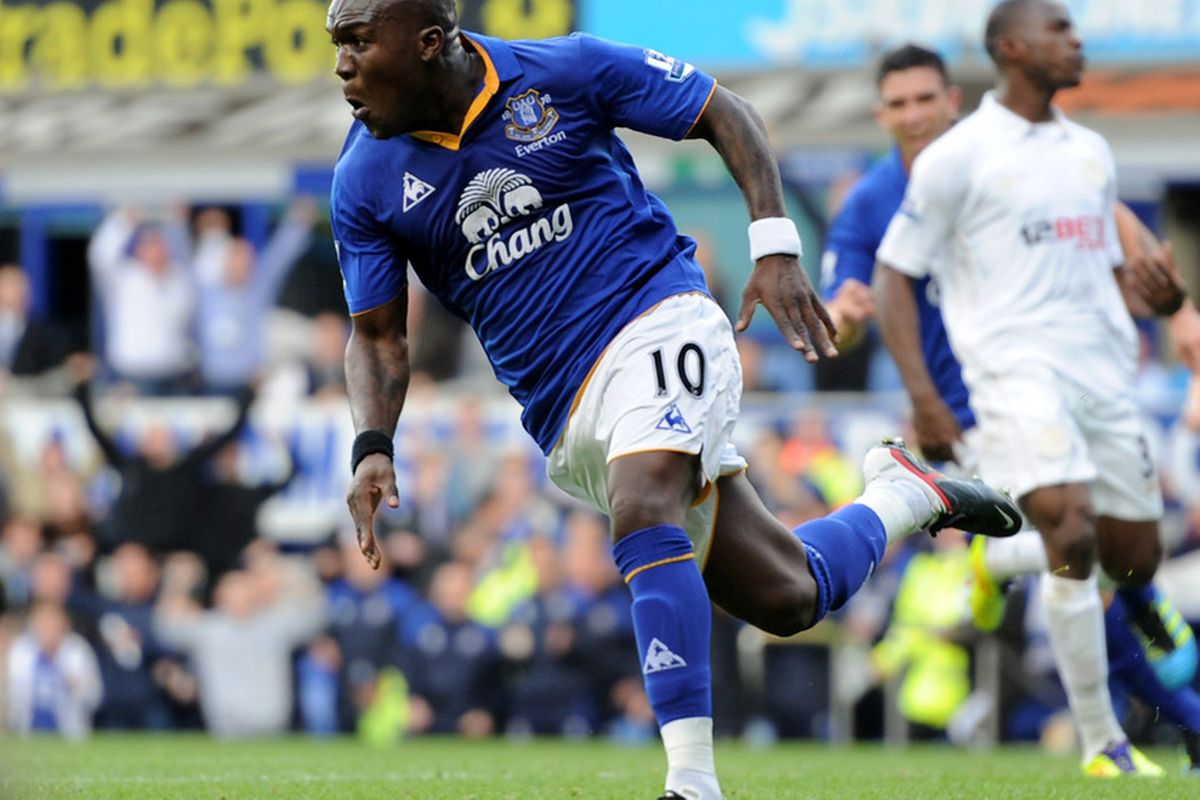 Royston Drenthe caps off the scoring with Everton's third goal against Wigan Athletic at Goodison Park on September 17, 2011 in Liverpool, England.  (Photo by Chris Brunskill/Getty Images)