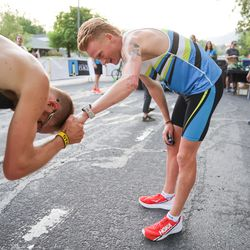 Rory Linkletter, right, who won the men's division of the Deseret News 10K, congratulates second-place finisher Jared Ward at Liberty Park in Salt Lake City on Friday, July 23, 2021.