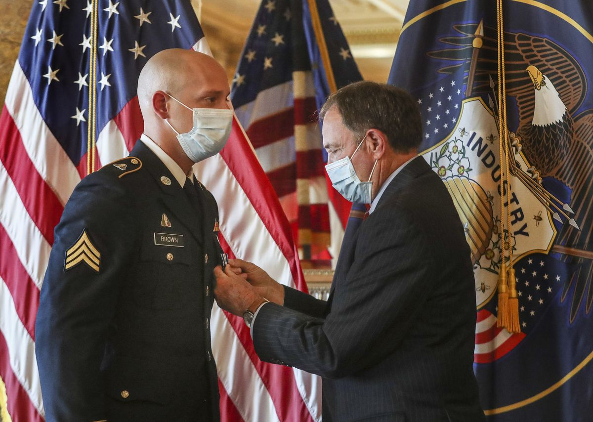 Gov. Gary Herbert pins the Utah Medal of Valor on Sgt. Chasen Brown, a service member of the Utah National Guard, in the Gold Room at the Utah State Capitol on Tuesday, Sept. 1, 2020. Brown, a gunner for Charlie Battery, 2nd Battalion, 222nd Field Artillery, was attending the Route 91 Harvest music festival in Las Vegas on Oct. 1, 2017. Shortly after the concert started, a man began shooting at the massive crowd. Without hesitation or regard to personal safety, Brown immediately rendered aide to the wounded while under constant gunfire. His actions on that day, also known as one of the deadliest mass shootings in the United States, saved the lives of dozens of fellow concertgoers.