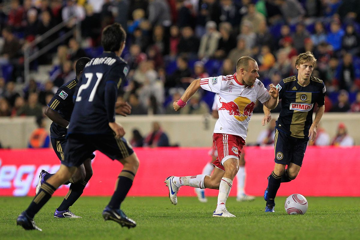 HARRISON, NJ - OCTOBER 20: Joel Lindpere #20 of the New York Red Bulls is pursued by Brian Carroll #7 of the Philadelphia Union at Red Bull Arena on October 20, 2011 in Harrison, New Jersey.  (Photo by Chris Trotman/Getty Images)