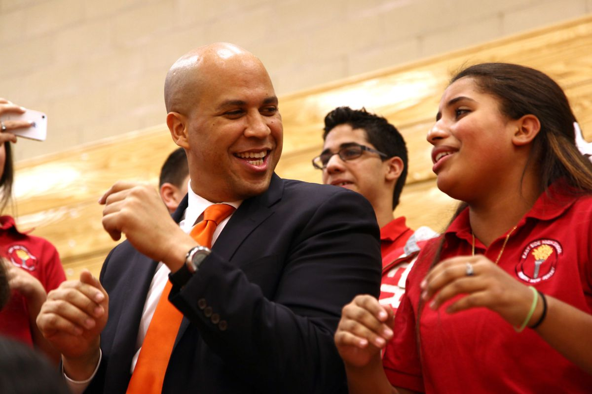 Cory Booker with students at Weequahic High School  when he was mayor of Newark, New Jersey. (Photo by Paul Zimmerman/WireImage)