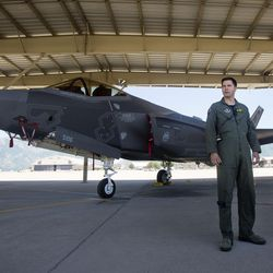 Air Force Lt. Col. Dave DeAngelis stands in front of a new F-35A Lightning II fighter jet as he discusses Independence Day flyovers across the state during a press conference at Hill Air Force Base about on Friday, June 30, 2017.