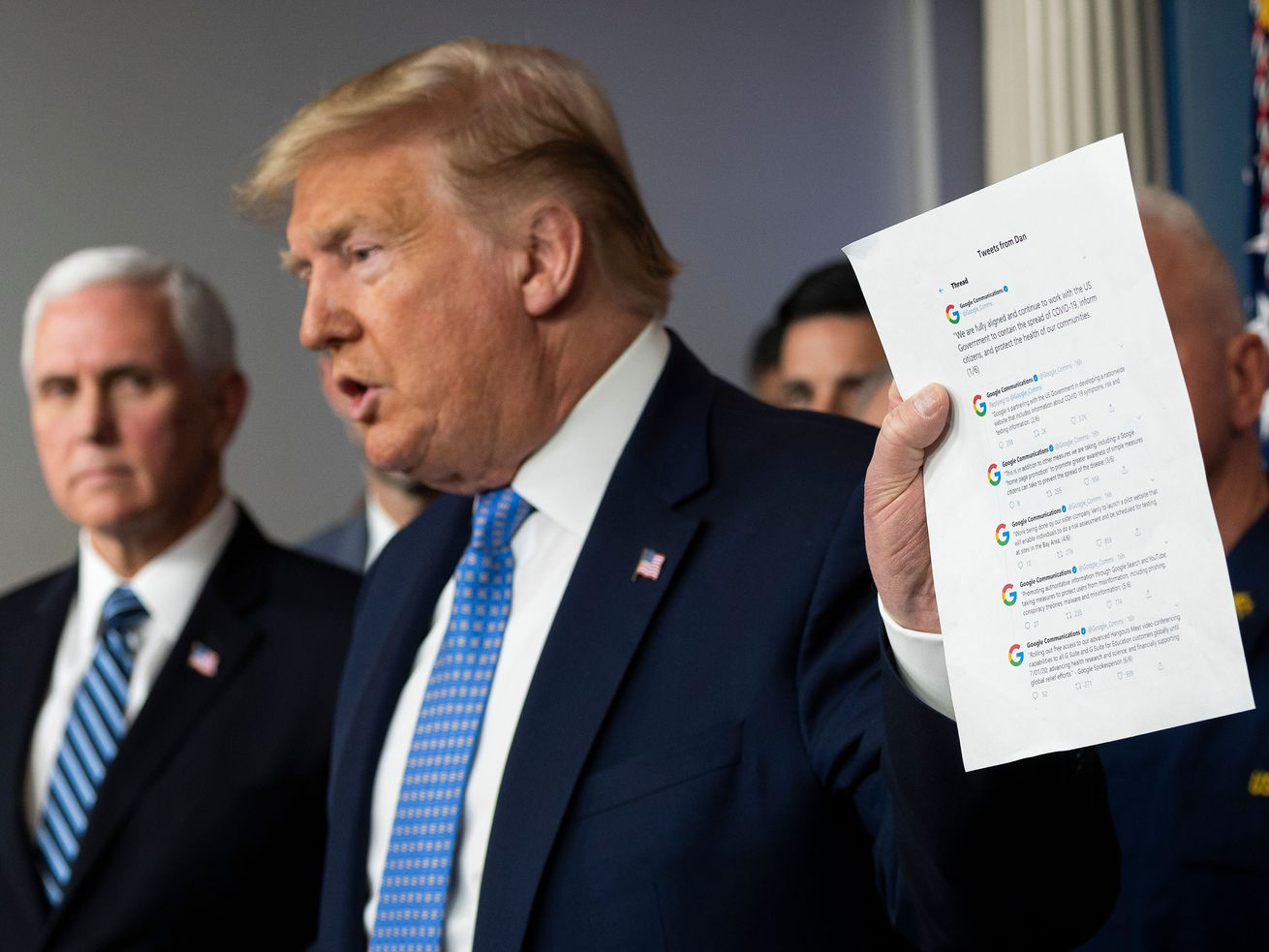 President Trump holds up a print out of tweets from Google's communication team.