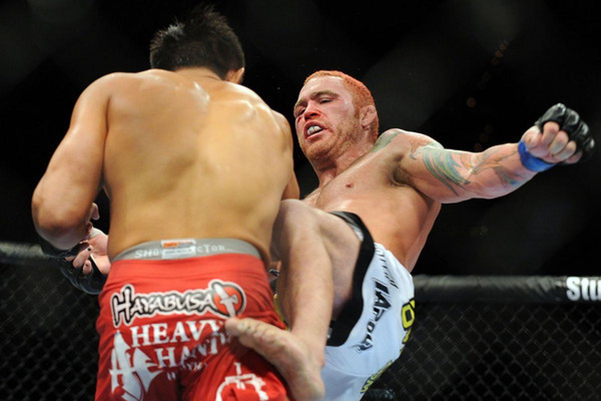LAS VEGAS - JULY 03:  (R-L) Chris Leben kicks Yoshihiro Akiyama of Japan during the UFC middleweight bout at the MGM Grand Garden Arena on July 3 2010 in Las Vegas Nevada.  (Photo by Jon Kopaloff/Zuffa LLC/Zuffa LLC via Getty Images)
