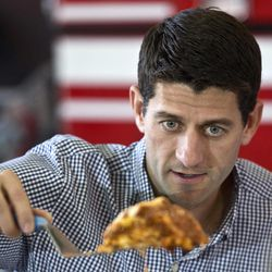 Republican vice presidential candidate, Rep. Paul Ryan, R-Wis. serves some lasagna during a lunch with firefighters, Tuesday, Sept. 11, 2012, in Oak Creek, Wis.