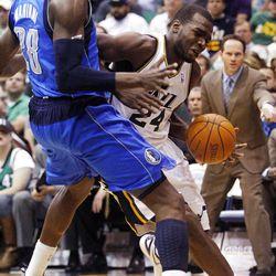 Utah Jazz forward Paul Millsap (24) battles with Dallas Mavericks center Ian Mahinmi (28) as the Utah Jazz and the Dallas Mavericks play Monday, April 16, 2012 in Salt Lake City.