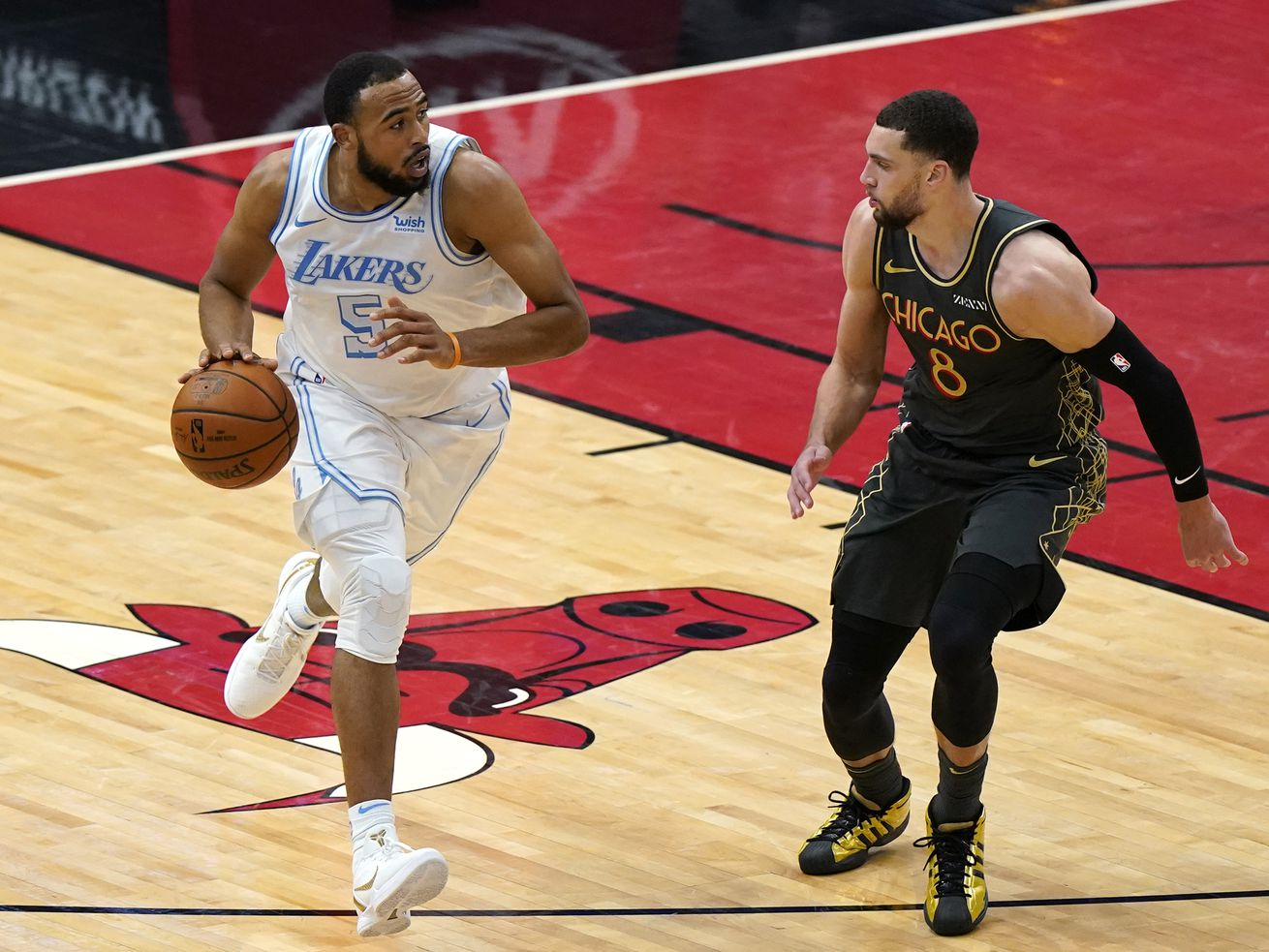 Los Angeles Lakers guard Talen Horton-Tucker, left, is defended by Chicago Bulls guard Zach LaVine during the second half of an NBA basketball game in Chicago.
