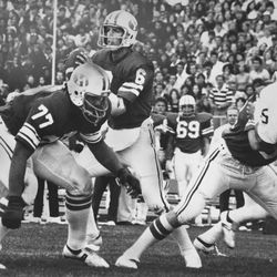 BYU Quarterbacks online photo gallery: BYU's Marc Wilson accumulated an NCAA record of 571 passing yards against Utah on Nov. 7, 1977.