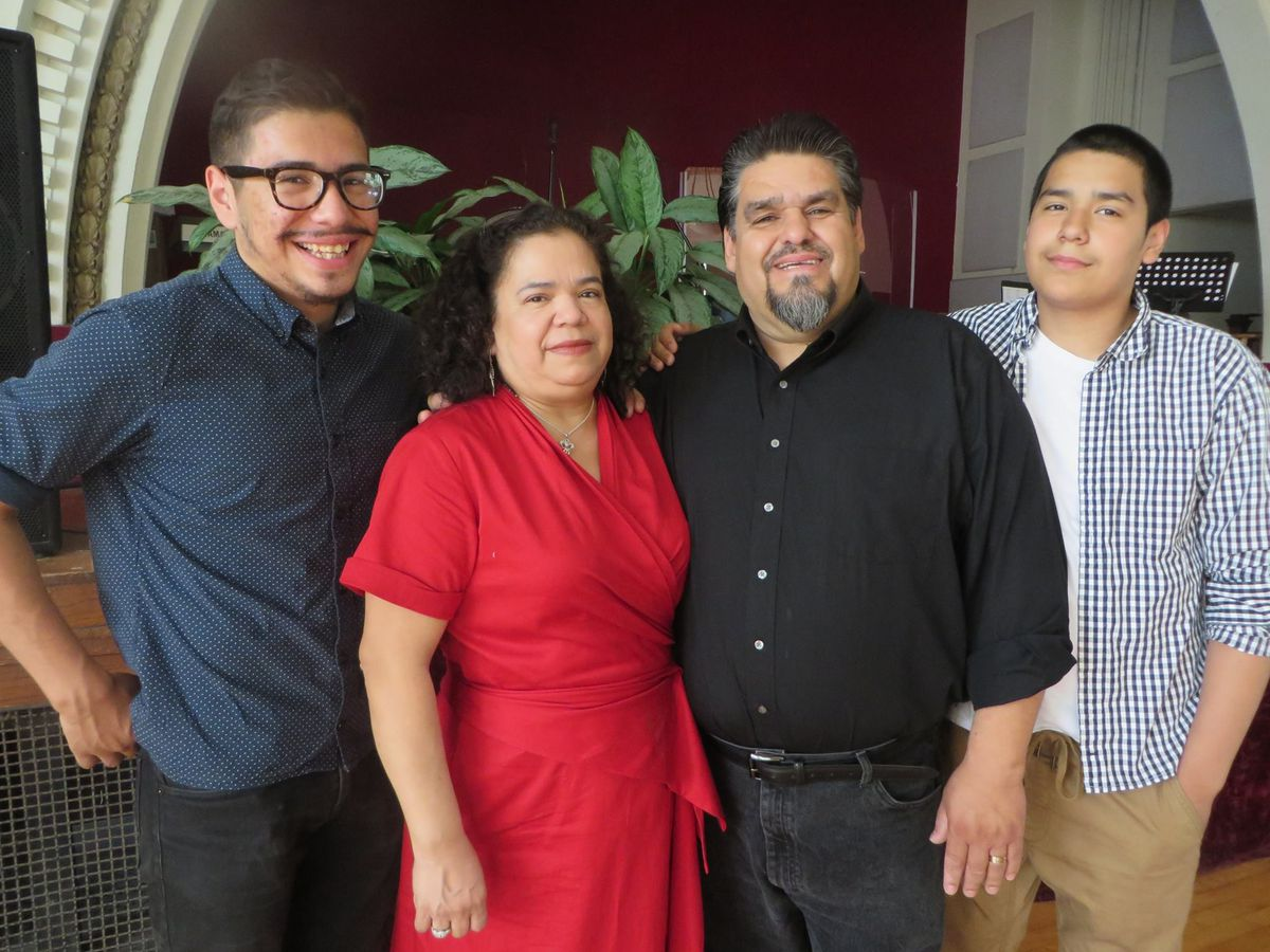 'Pastor Vic' Rodriguez with Magdalena, his wife of 27 years, and sons Victor (left) and Isaiah (right). | Provided photo