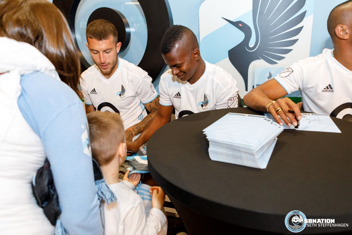 February 10, 2019 - Bloomington, Minnesota, United States - Francisco Calvo and Darwin Quintero sign autographs for a young fan at the Minnesota United 2019 kit reveal.  (Photo by Seth Steffenhagen/Steffenhagen Photography)