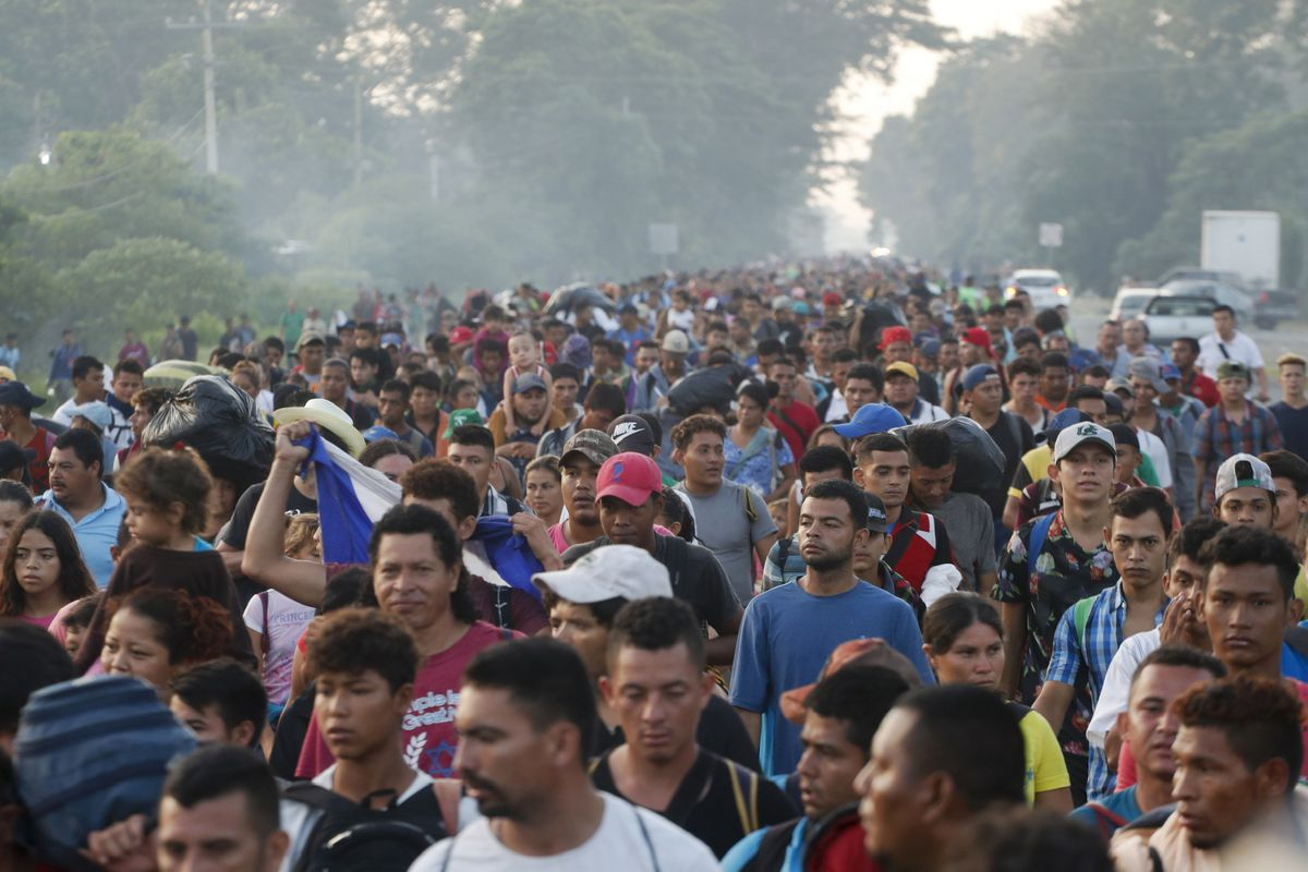 Central American migrants walking to the U.S. start their day departing Ciudad Hidalgo, Mexico, Sunday, Oct. 21, 2018. Despite Mexican efforts to stop them at the border, about 5,000 Central American migrants resumed their advance toward the U.S. border e