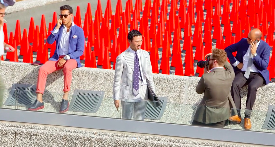 Man being photographed on the street at Italy's Pitti Uomo
