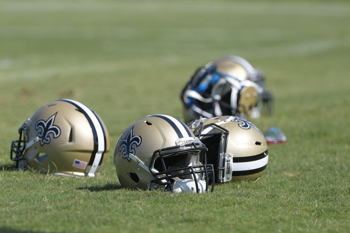 Costa Mesa, CA, USA; New Orleans Saints helmets rest on the field during joint practices with the Los Angeles Chargers at the Jack Hammett Sports Complex.