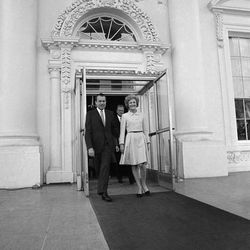 President  Richard Nixon and Pat Nixon stand at the White House North Portico on Jan. 26, 1969 in Washington after evangelist Billy Graham and his wife attended a church service in the East Room.  The President, a Quaker, plans on inviting pastors of different religions to officiate at the weekly services for his family and invited guests. (AP Photo/Harvey Georges)