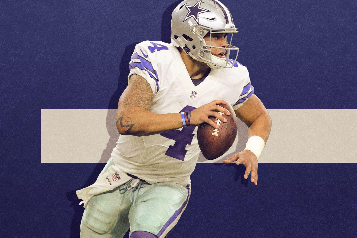 Dak Prescott holding a football