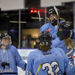 Buffalo Beauts forward Taylor Accursi celebrates a goal with her line by leaping into the arms of Corinne Buie during a NWHL preseason game vs. Team China at HarborCenter in Buffalo, NY on October 9th, 2017.