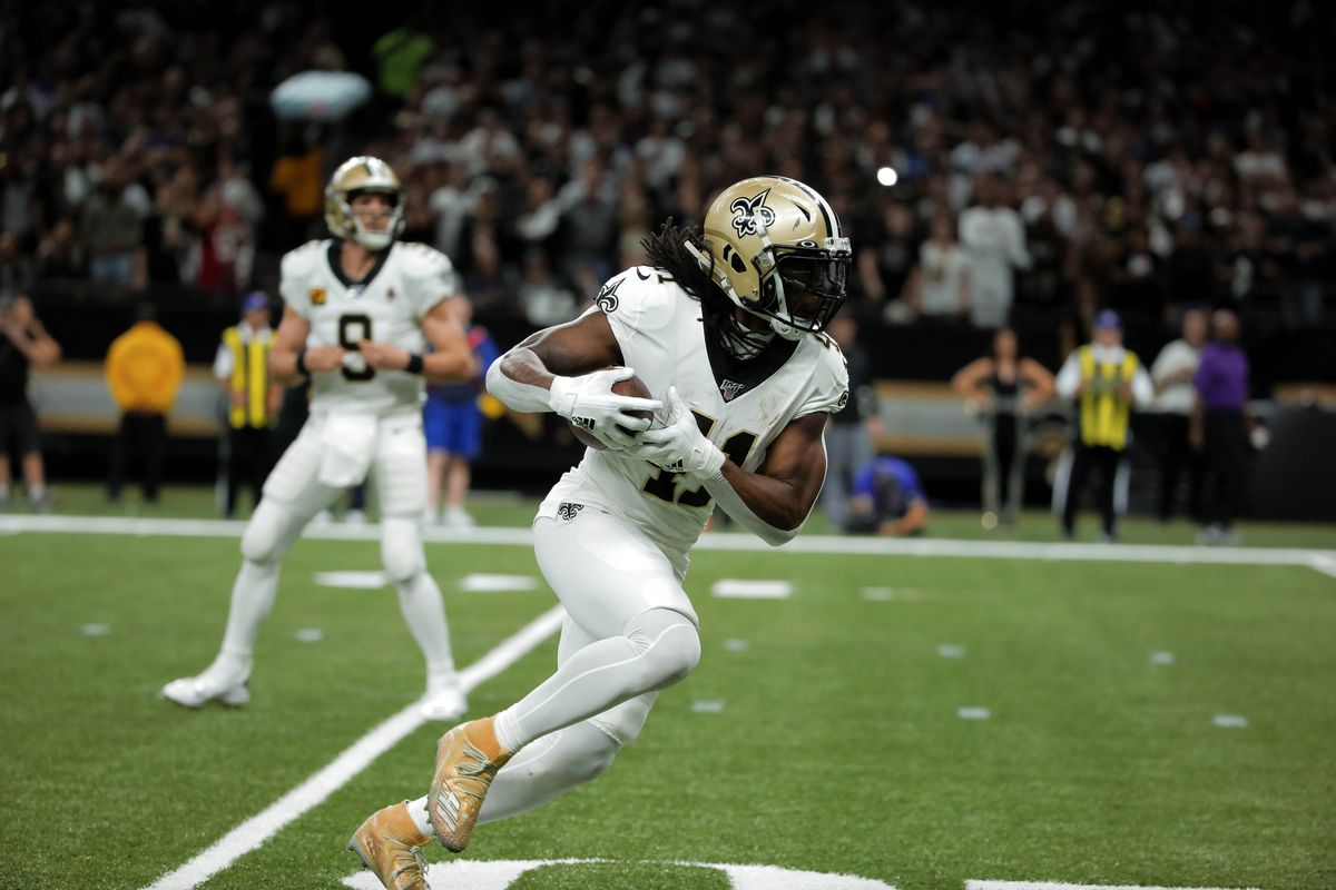 New Orleans Saints running back Alvin Kamara runs for a touchdown against the Minnesota Vikings during the second quarter of a NFC Wild Card playoff football game at the Mercedes-Benz Superdome.