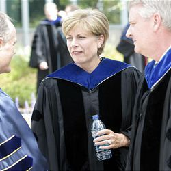 John S. Tanner, left, speaks with Sister Julie Beck, general Relief Society president, before BYU's summer commencement exercises at the Marriott Center in Provo on Thursday.