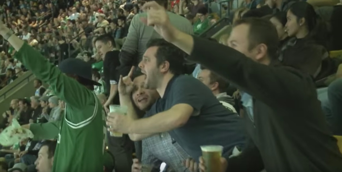 Crowd cheering at a basketball game