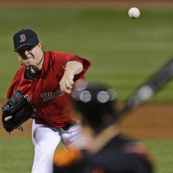 Boston Red Sox starting pitcher Jon Lester throws against the Baltimore Orioles during the first inning of a baseball game at Fenway Park in Boston, Friday, Sept. 21, 2012.
