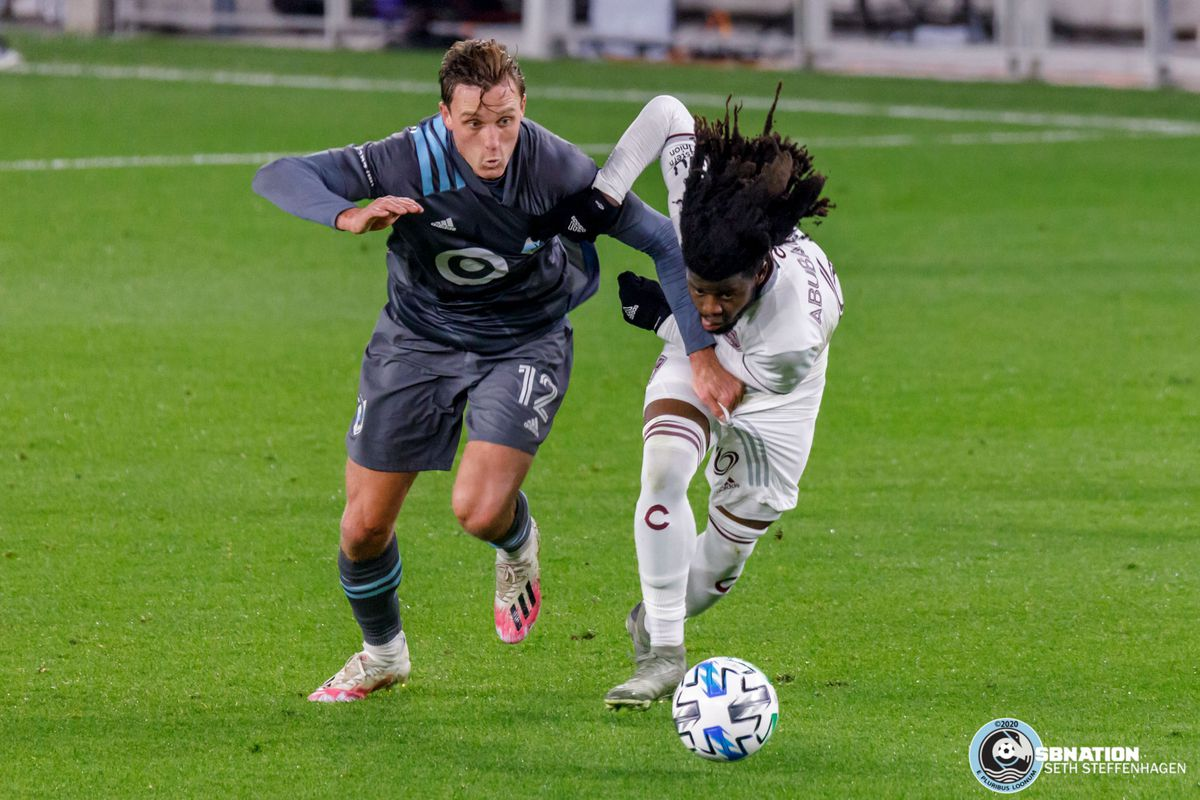 October 28, 2020 - Saint Paul, Minnesota, United States - Minnesota United forward Aaron Schoenfeld (12) and Colorado Rapids defender Lalas Abubakar (6) chase down a loose ball during the match at Allianz Field.