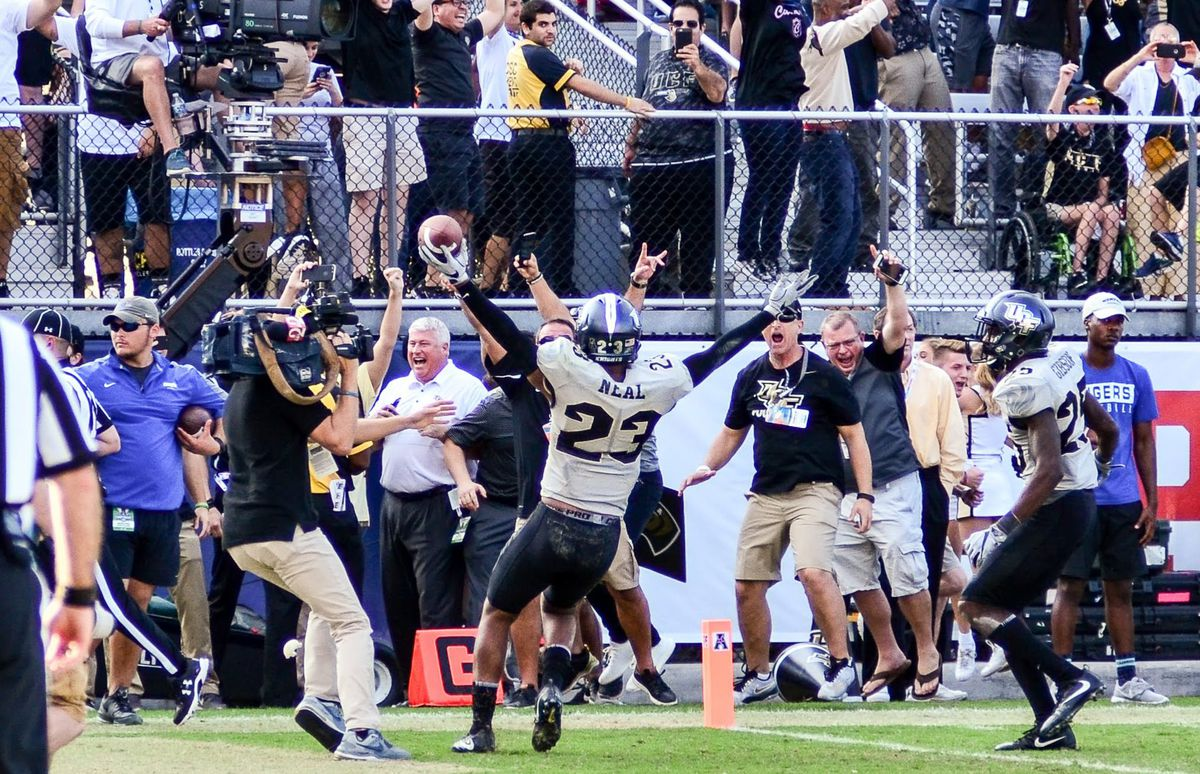 Tre Neal celebrates intercepting the final pass of the American Athletic Championship Game against Memphis. Photo: Derek Warden)
