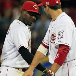 Cincinnati Reds' Brandon Phillips, left, and Joey Votto slap hands after they defeated the Pittsburgh Pirates 5-3 in a baseball game, Tuesday, Sept. 11, 2012, in Cincinnati. Phillips hit a home run and had two RBI's in the game.