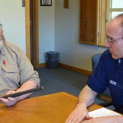 KMXT-FM news director Jay Barrett asks Coast Guard Capt. Karl Moore, commander of Base Support Unit Kodiak about Thursday morning's shooting during a news conference April 12, 2012 in Kodiak, Alaska.