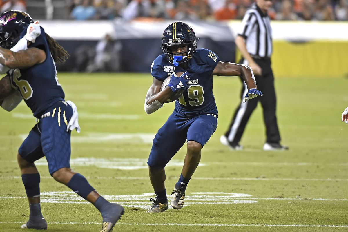 FIU wide receiver Shemar Thornton takes a reception 29 yards for a touchdown in the first quarter as the FIU Golden Panthers faced the University of Miami Hurricanes on November 23, 2019, at Marlins Park in Miami, Florida.