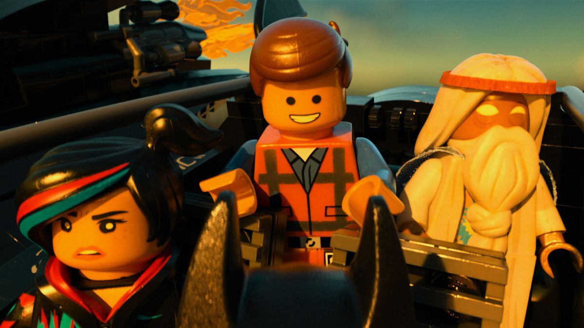 three Lego figures in The Lego Movie: a woman with black hair and red and blue streaks, a man in an orange construction vest, and an old man with a long white beard