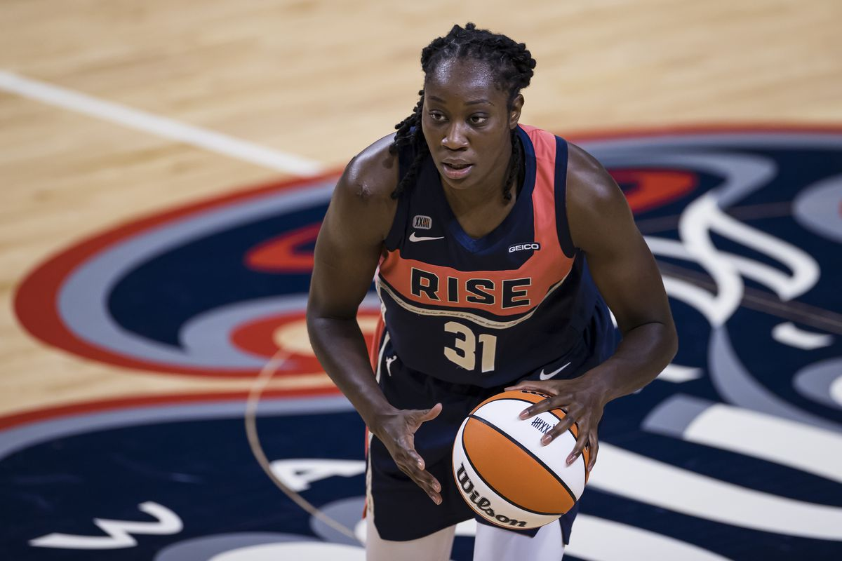 Tina Charles #31 of the Washington Mystics dribbles the ball against the Connecticut Sun during the second half of the game at Entertainment & Sports Arena on June 29, 2021 in Washington, DC.