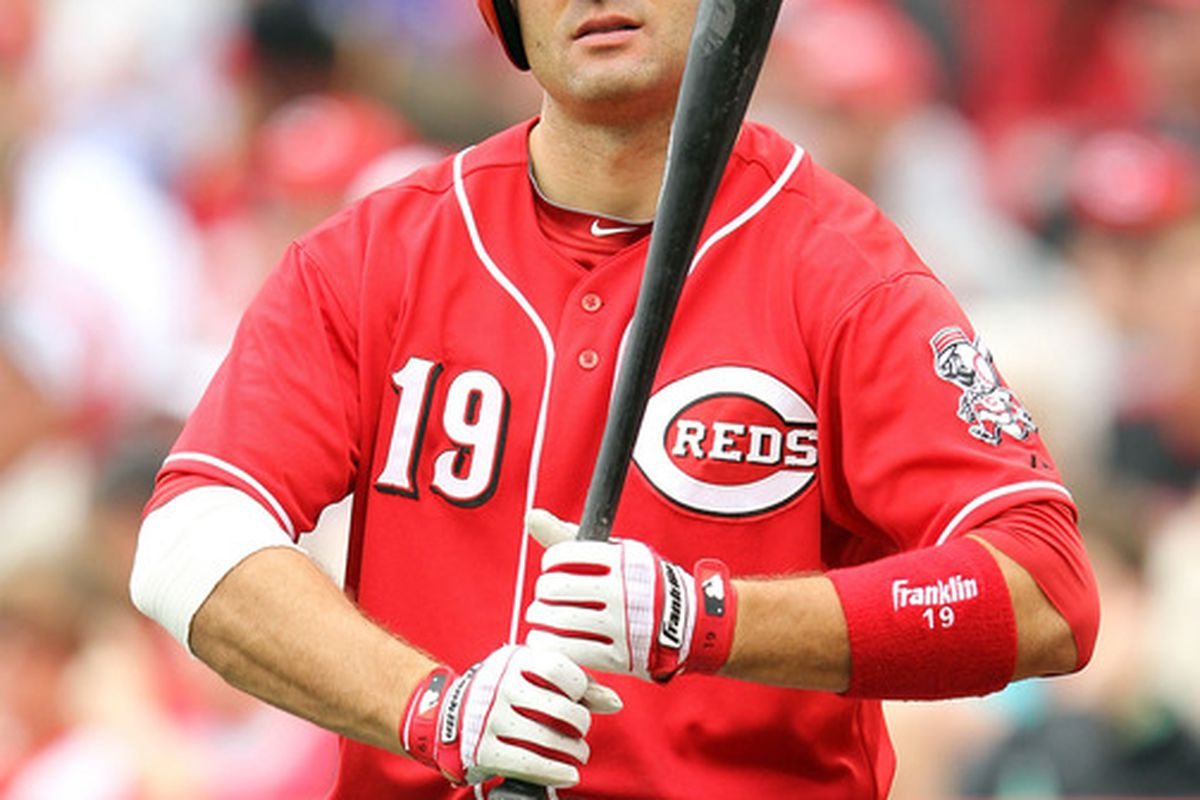 """Votto receiving the sign from Mark Berry to """"be self."""""""