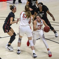The Utah Utes and Stanford Cardinal fight for the ball during a women's basketball game at the Huntsman Center in Salt Lake City on Friday, Jan. 15, 2021.